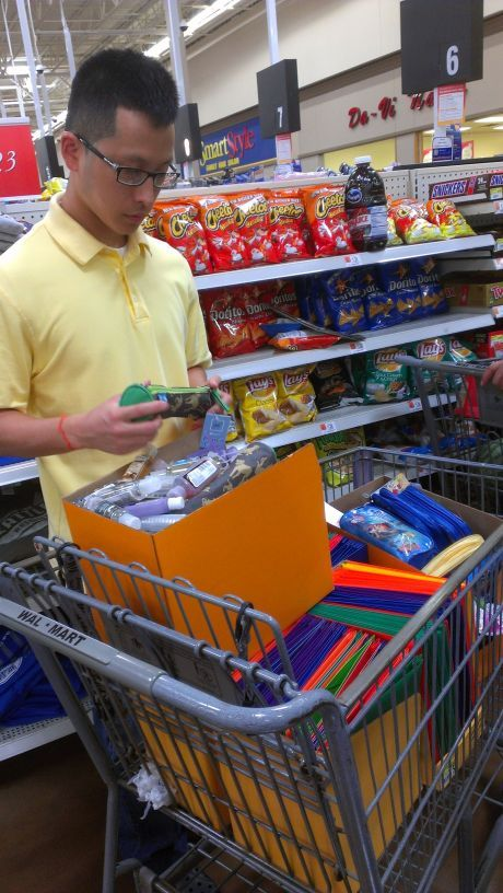 Curtis, FOL's Chief Operating Officer, buying school supplies to be donated